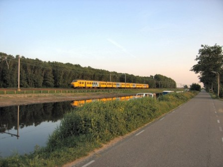 The regional trein from Leiden to Zandvoort passing by the Leidse Trekvaart, a mid-17th-century canal between the cities of Haarlem and Leiden. This railroad was originally built in the 1840s and is one of the oldest of the Netherlands.